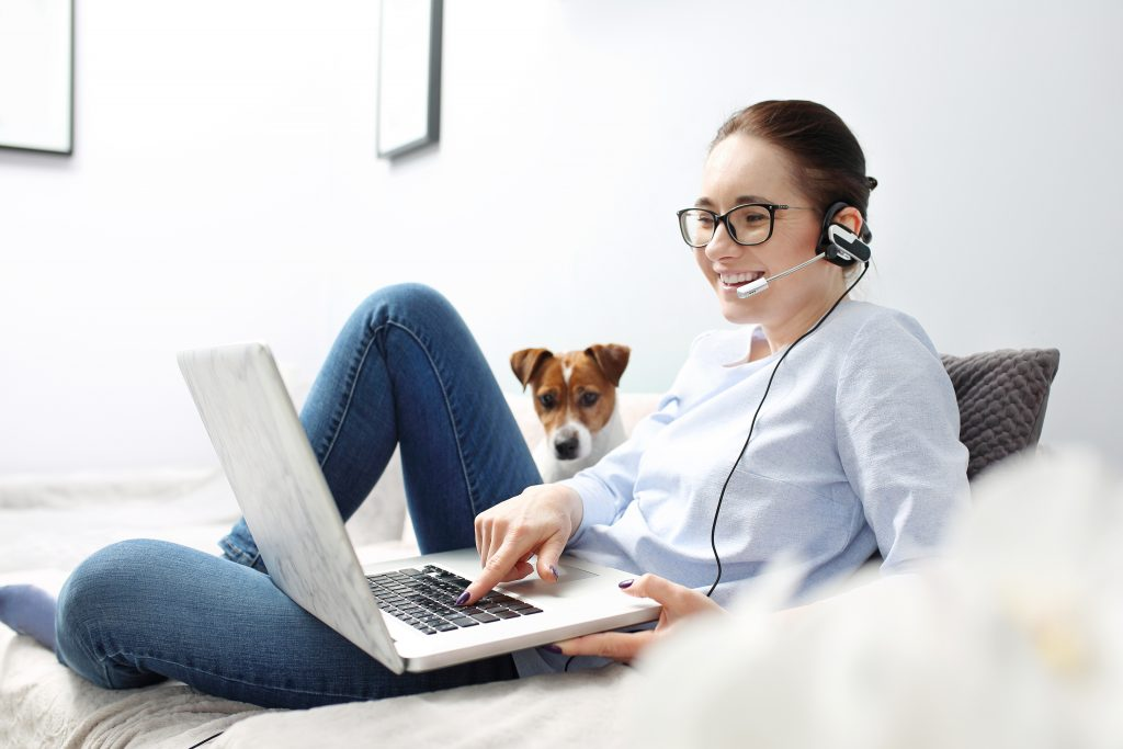 Woman on video call with dog